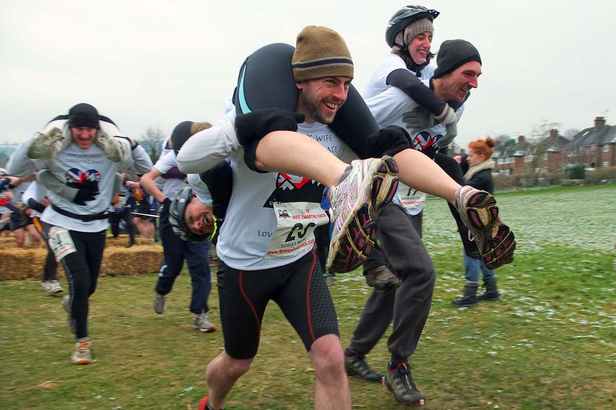 22/03/13.   METRO FEATURES : UK WIFE CARRYING CHAMPIONSHIPS.   METRO JOURNALIST TOBIAS MEWS & PARTNER ZAYNE PARTICIPATE IN THE UK WIFE CARRYING CHAMPIONSHIPS IN DORKING, SURREY.   CREDIT: DANIEL LYNCH.  07941 594 556.  www.lynchpix.co.uk